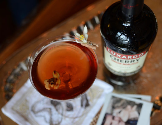 cocktail with cherry liqueur and toasted walnut