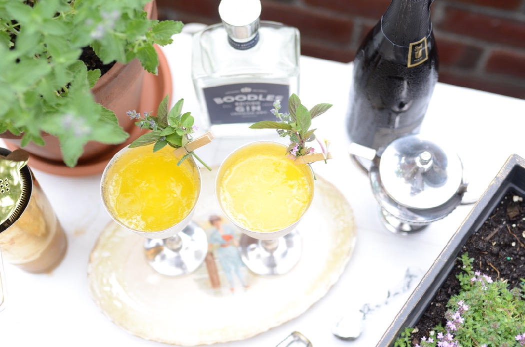 yellow cocktail with Boodles Gin with mint garnish